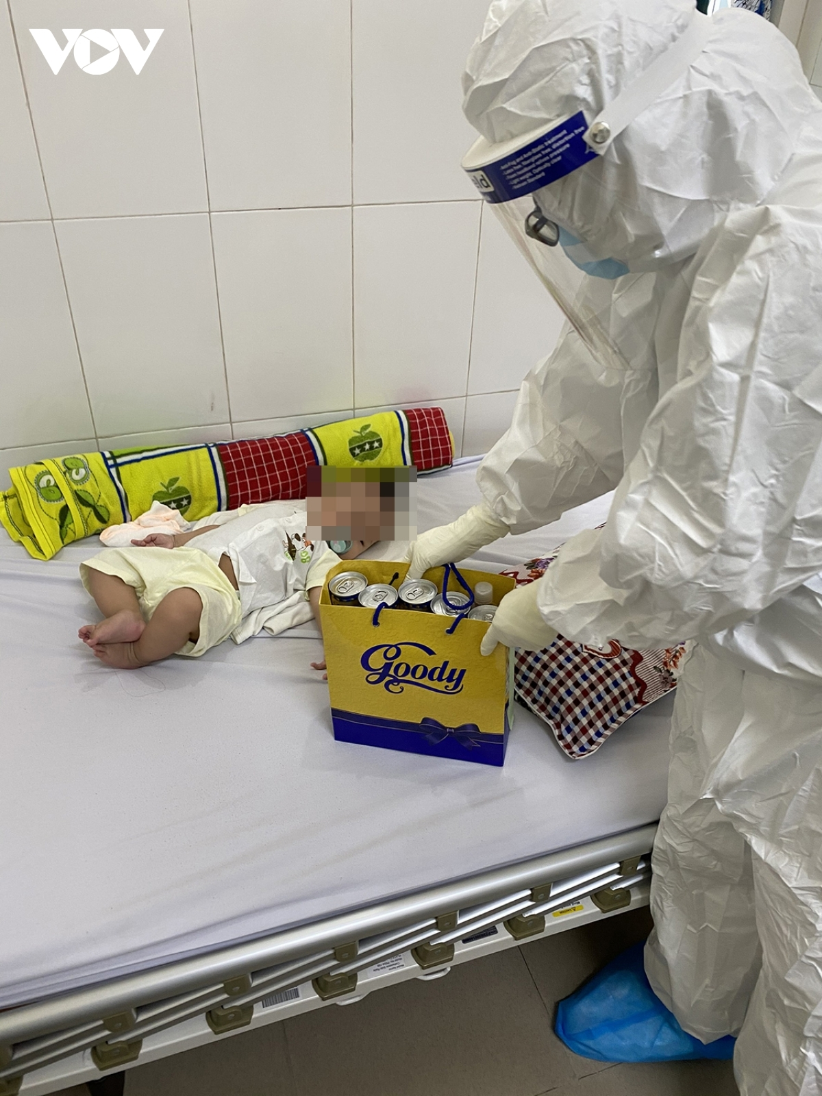 A doctor prepares a special gift for a six-month-old baby in the Da Nang Lung Hospital.