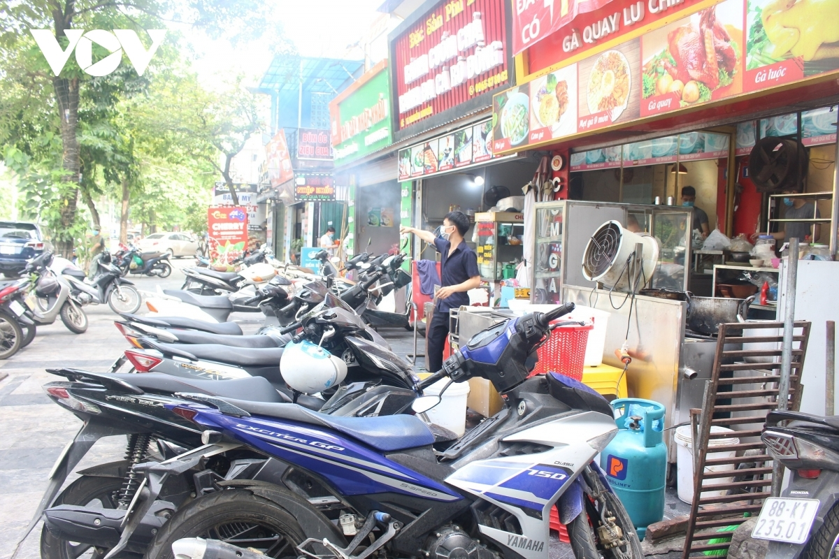 The pavement is full of the vehicles belonging to customers.