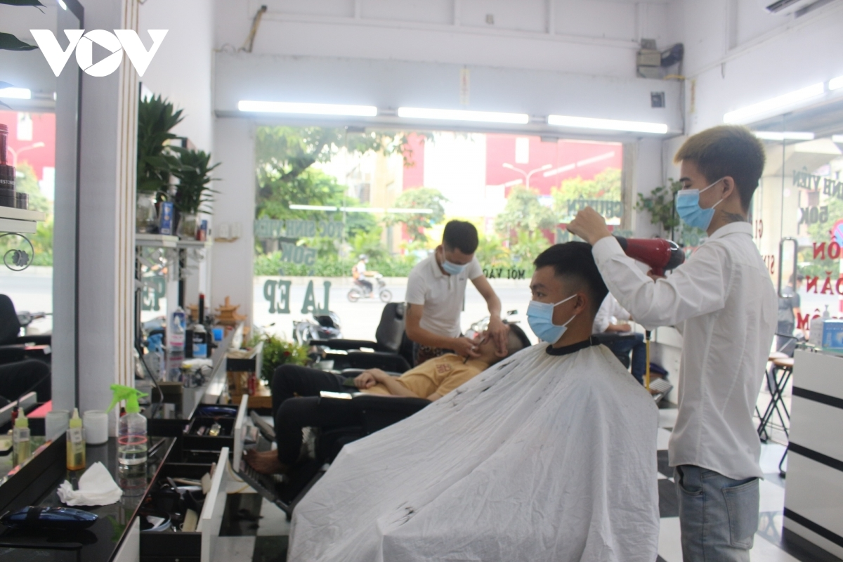Customers visit local hair salons from the early morning.