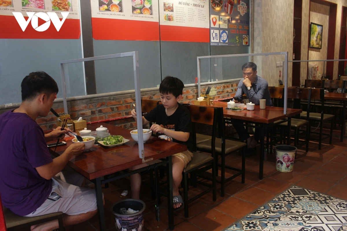 Diners try to keep a safe distance from others.
