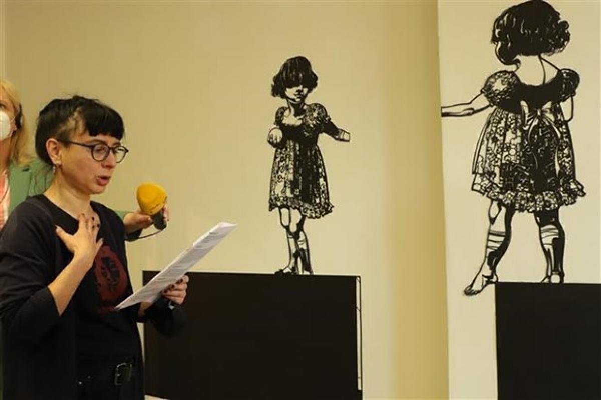 German artist Franca Bartholomäi speaks at the press conference