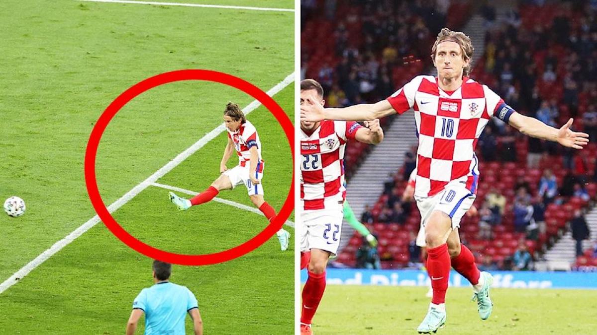 Luka Modric lập siêu phẩm trivela vào lưới Scotland. (Ảnh: Yahoo Sports)