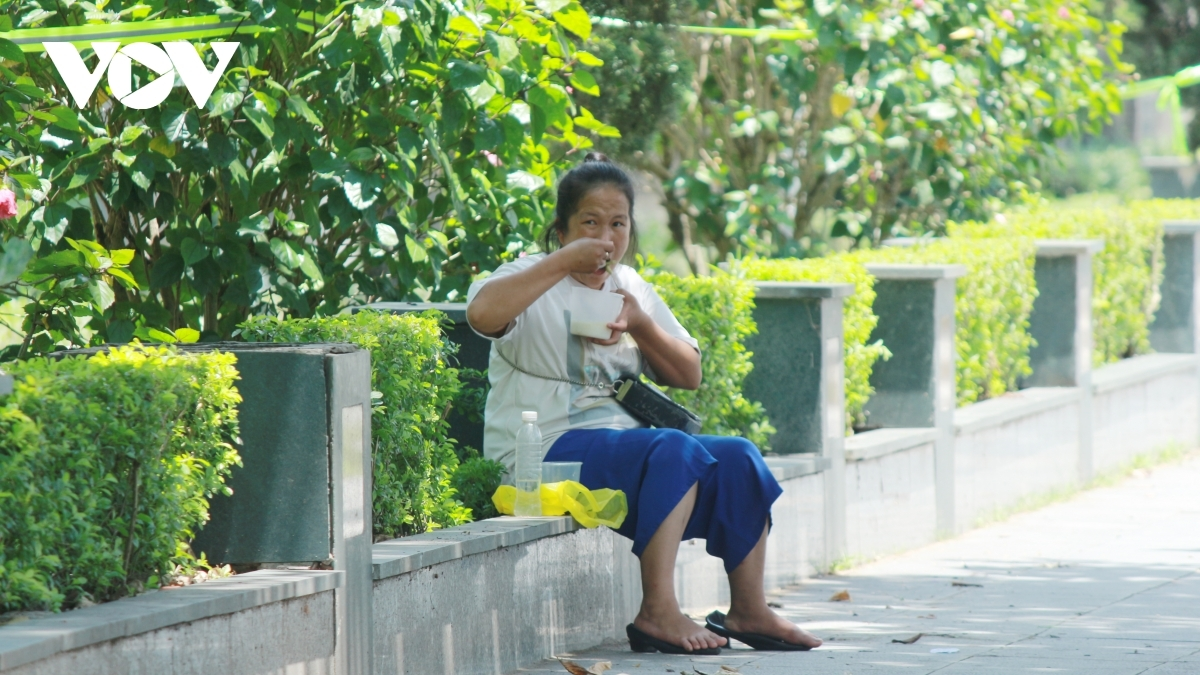 After eating, this poor worker dons her face mask and doesn't linger in the park for too long amid COVID-19 fears.