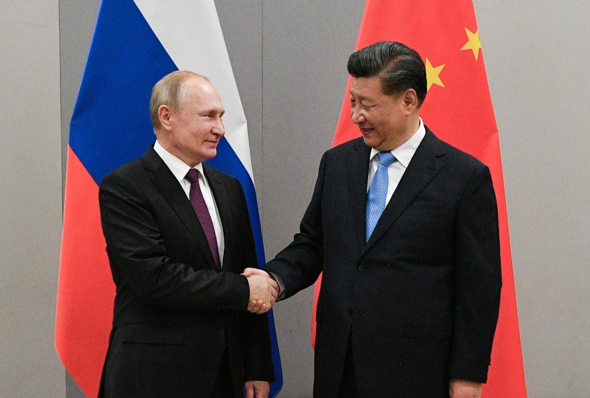 Tổng thống Nga Vladimir Putin và Chủ tịch Trung Quốc Tập Cận Bình trong cuộc gặp ở Brazil hồi tháng 11/2019. Ảnh: Reuters