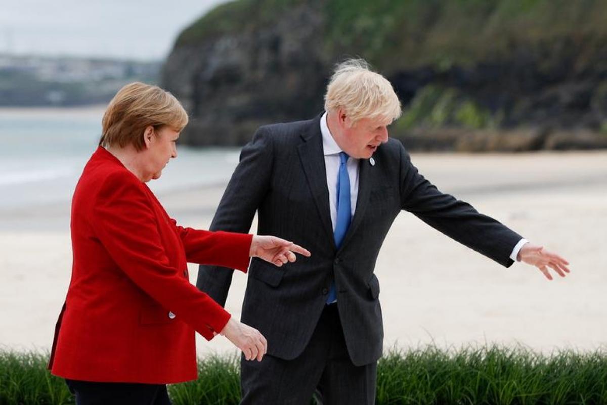 Thủ tướng Anh Boris Johnson và Thủ tướng Đức Angela Merkel. Ảnh: Reuters
