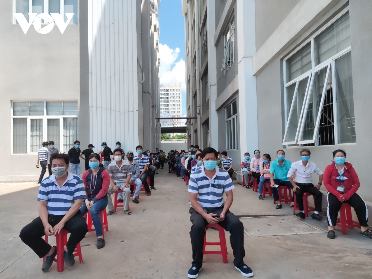 Strongman Co. Ltd sees 538 workers inoculated against the virus. They don face masks and maintain a safe distance at all times while waiting for the vaccination.