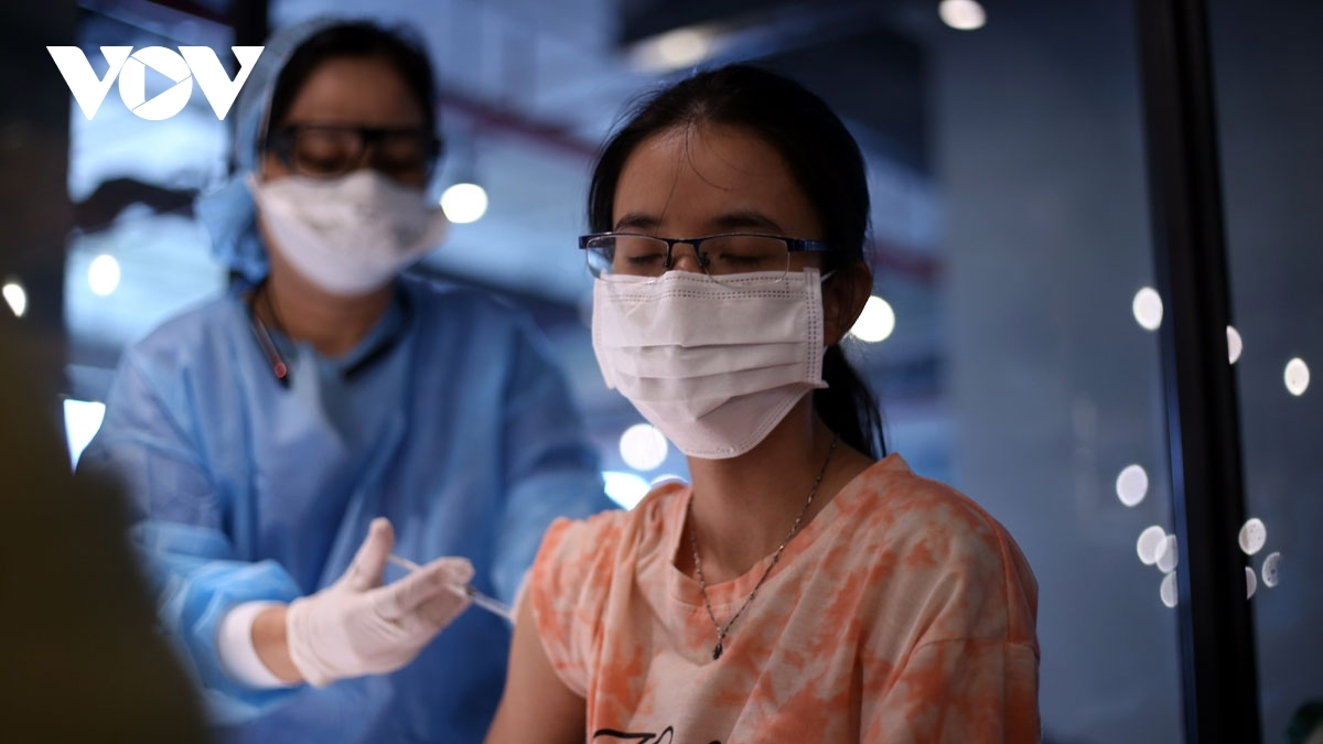 A female worker of VNG Corporation feels a bit nervous while being vaccinated, but she is aware vaccination is the most effective way to protect people from virus infection.