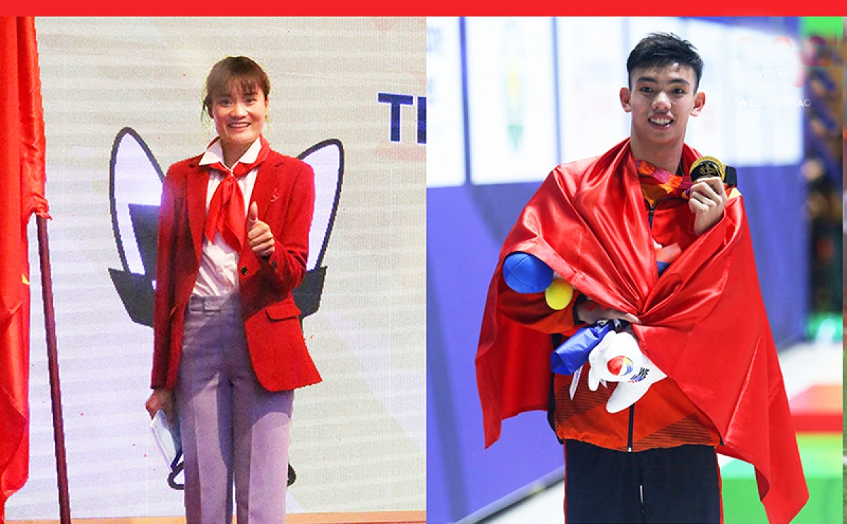 Quach Thi Lan and Nguyen Huy Hoang (L-R) are twoflagbearers ofthe Vietnamese sports delegation during the opening ceremony of the 2020 Tokyo Olympics.
