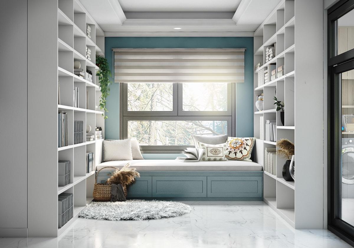 Bảng màu xanh lam dịu nhẹ, kết hợp với giá sách màu trắng mang lại một thư viện gia đình đầy sự trẻ trung và tươi mới.