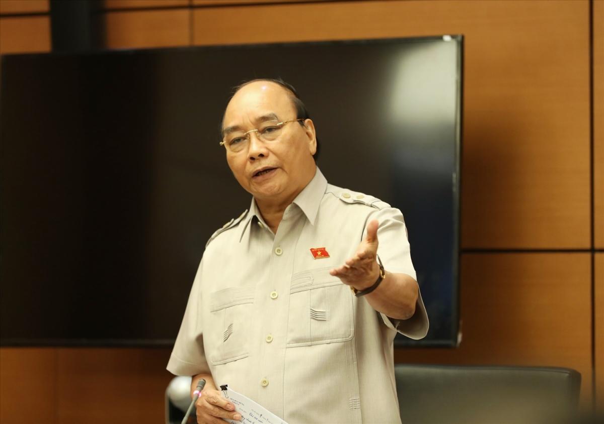 Chủ tịch nước Nguyễn Xuân Phúc tại một phiên thảo luận tổ (Ảnh: VGP)