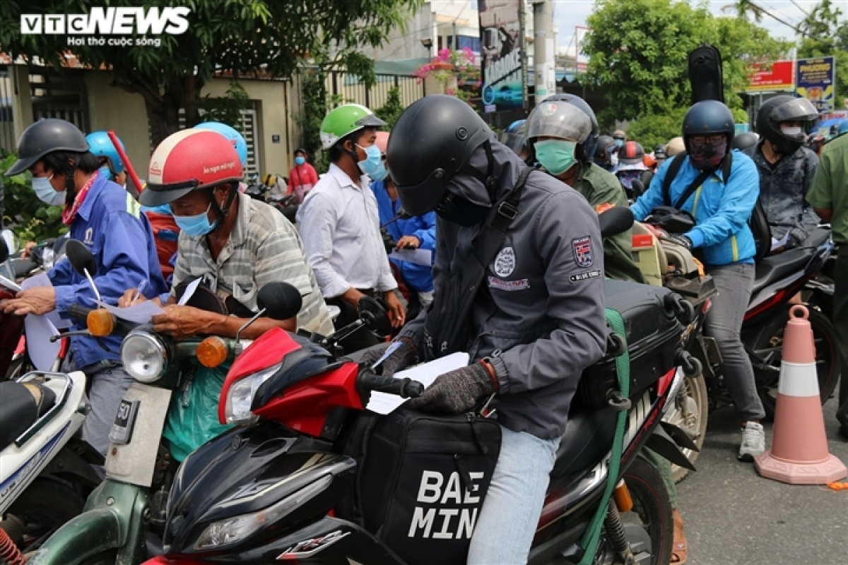 Many people take time to complete information forms on their motorbikes.