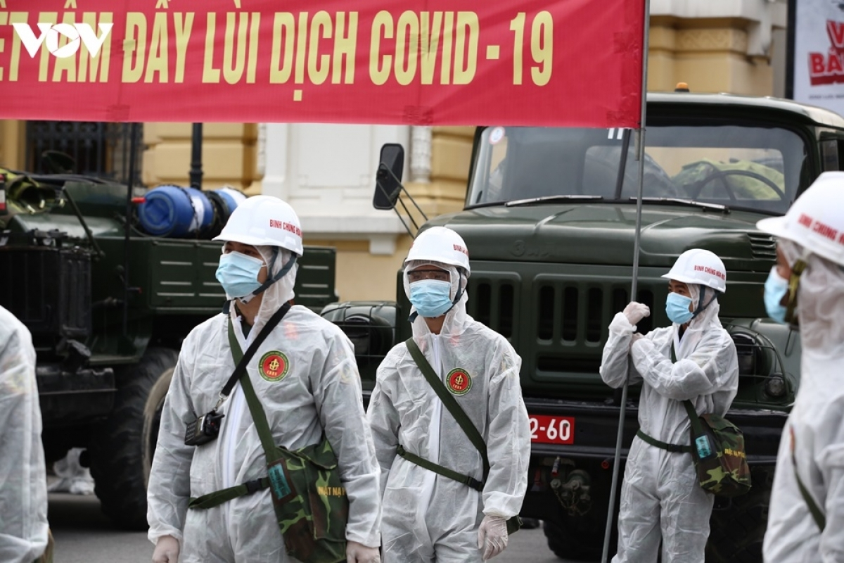 Hundreds of soldiers donning full-protective gear are deployed at various places throughout Hanoi to undertake the task.