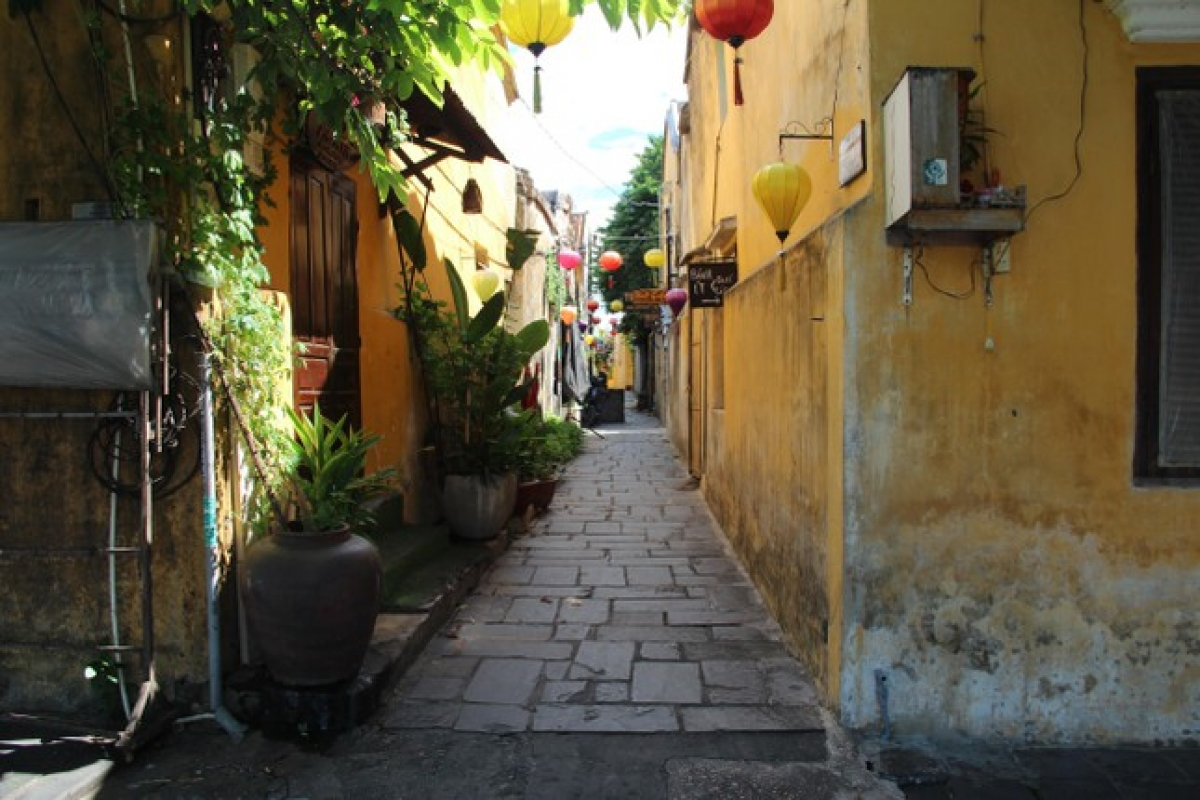 A downbeat atmosphere descends on the iconic yellow-painted houses of Hoi An, which are usually packed full of visitors.
