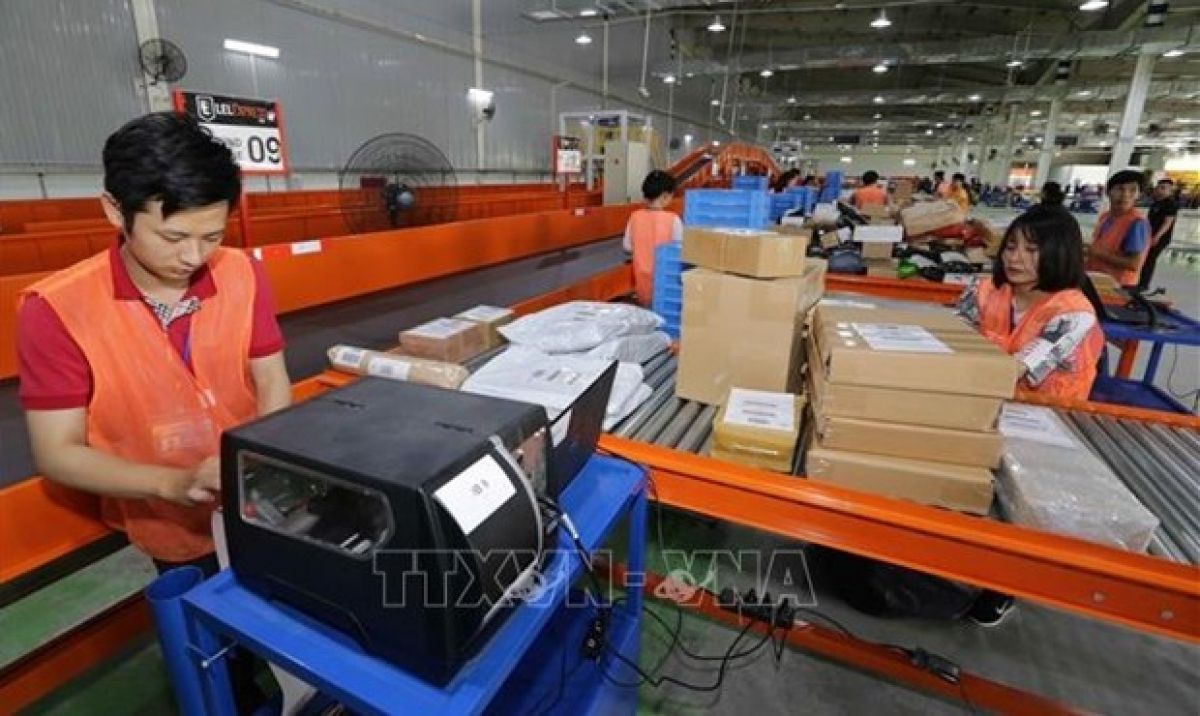 Workers of the Lazada e-commerce platform sort goods before delivery