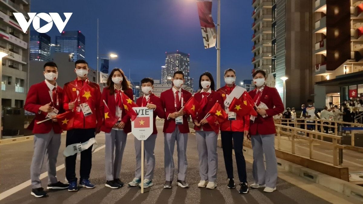 The Vietnamese team participate in the opening ceremony of the Olympics on July 23.