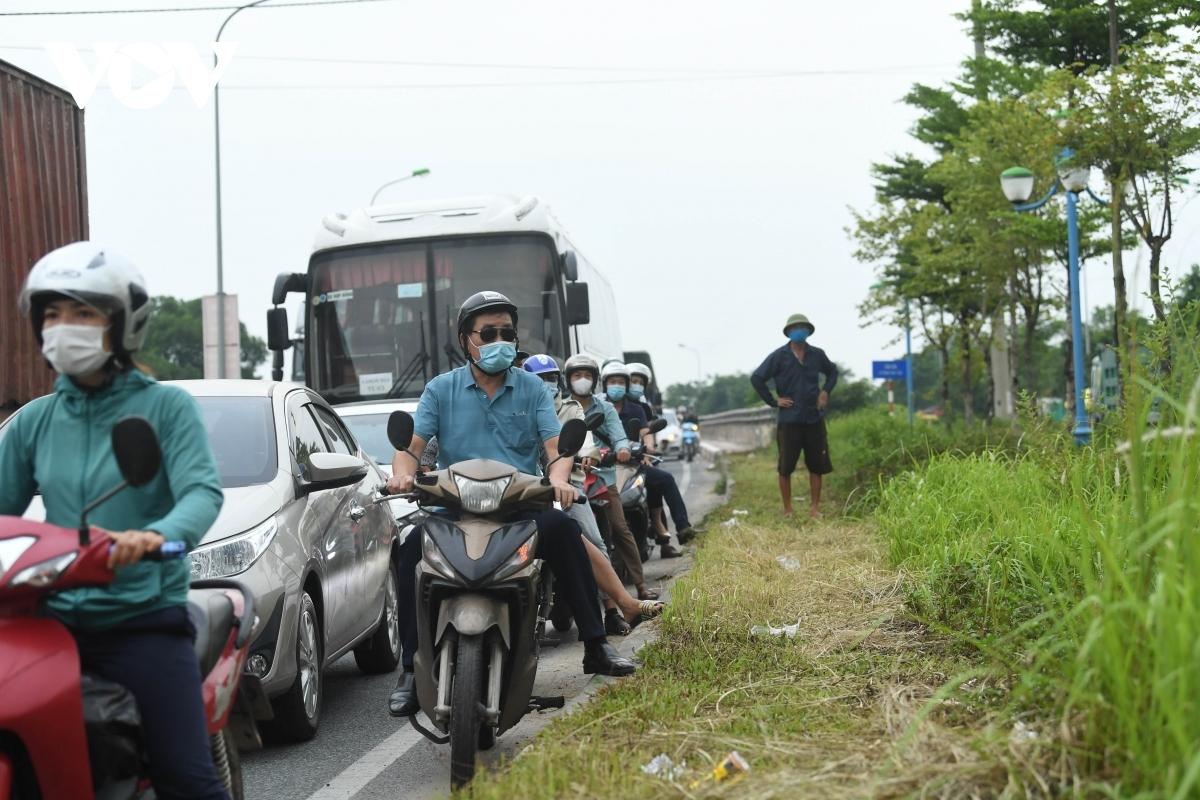 Similar traffic congestion forms among motorbike drivers.