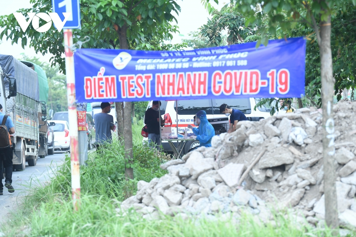 A place to undergo a quick COVID-19 test is set up at one of the entrances to Hanoi.