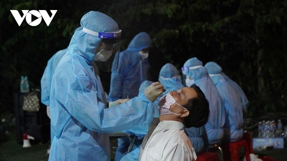 Taking nasal swabs for COVID-19 testing in a lockdown area in Vietnam