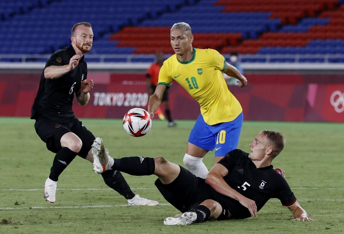 Richarlison tỏa sáng rực rỡ với một hat-trick vào lưới Đức. (Ảnh: Reuters).