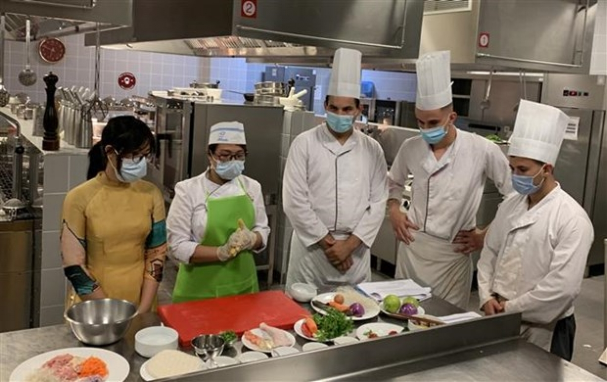 Students at the ESHRA learn to cook Vietnamese nem (fried spring rolls)