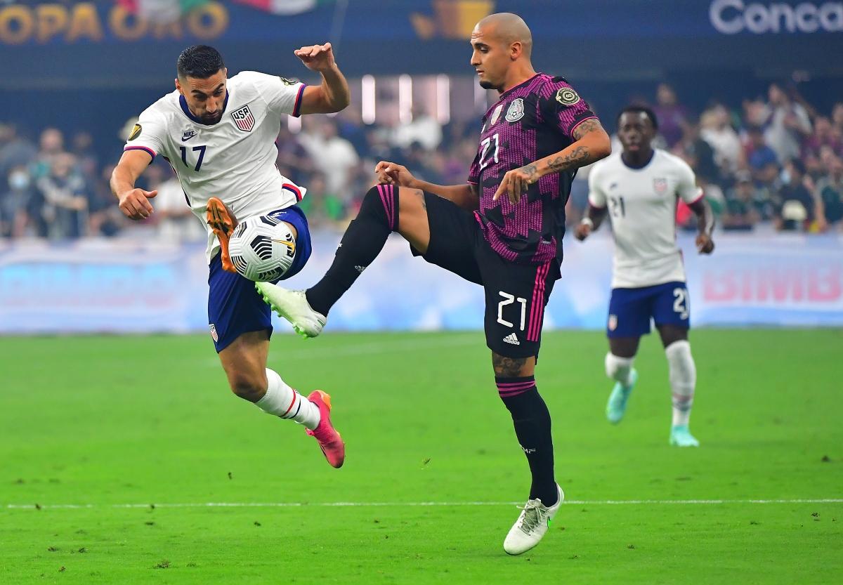 ĐT Mỹ (áo trắng) đăng quang chức vô địch Gold Cup sau trận thắng kịch tính trước Mexico. (Ảnh: Reuters).