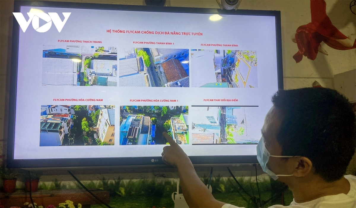 Images taken by drones appear at a control centre at the headquarters of Hai Chau district's administration.