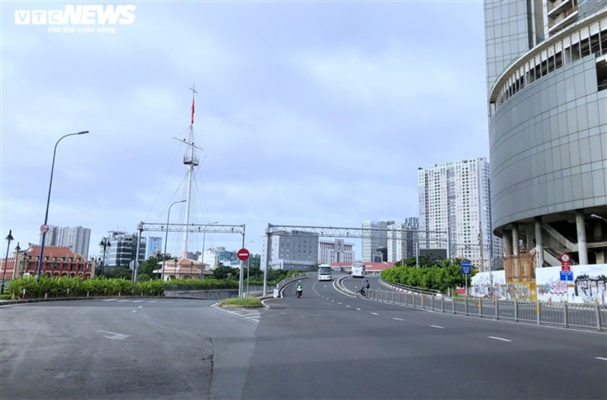 Only a few vehicles can be seen on Vo Van Kiet Boulevard