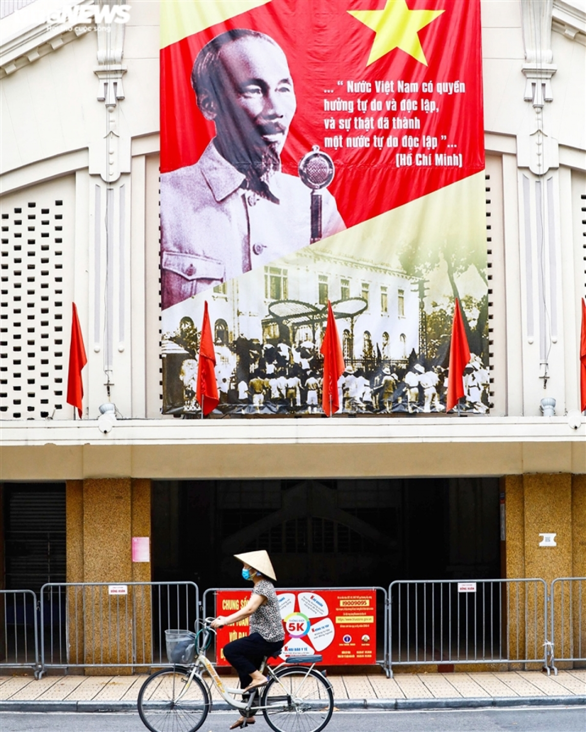 Large posters and billboards to mark the day are on show at Dong Xuan market