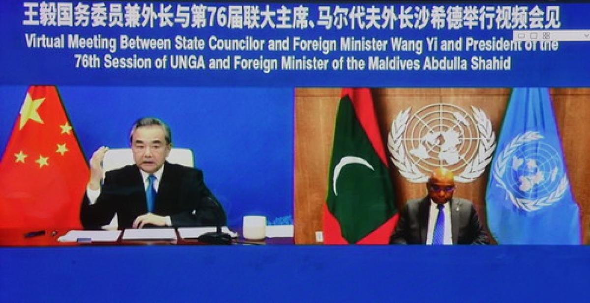 Bộ trưởng Ngoại giao Vương Nghị hội kiến với Chủ tịch Đại hội đồng LHQ Abdulla Shahid. (Ảnh: Chinamission)