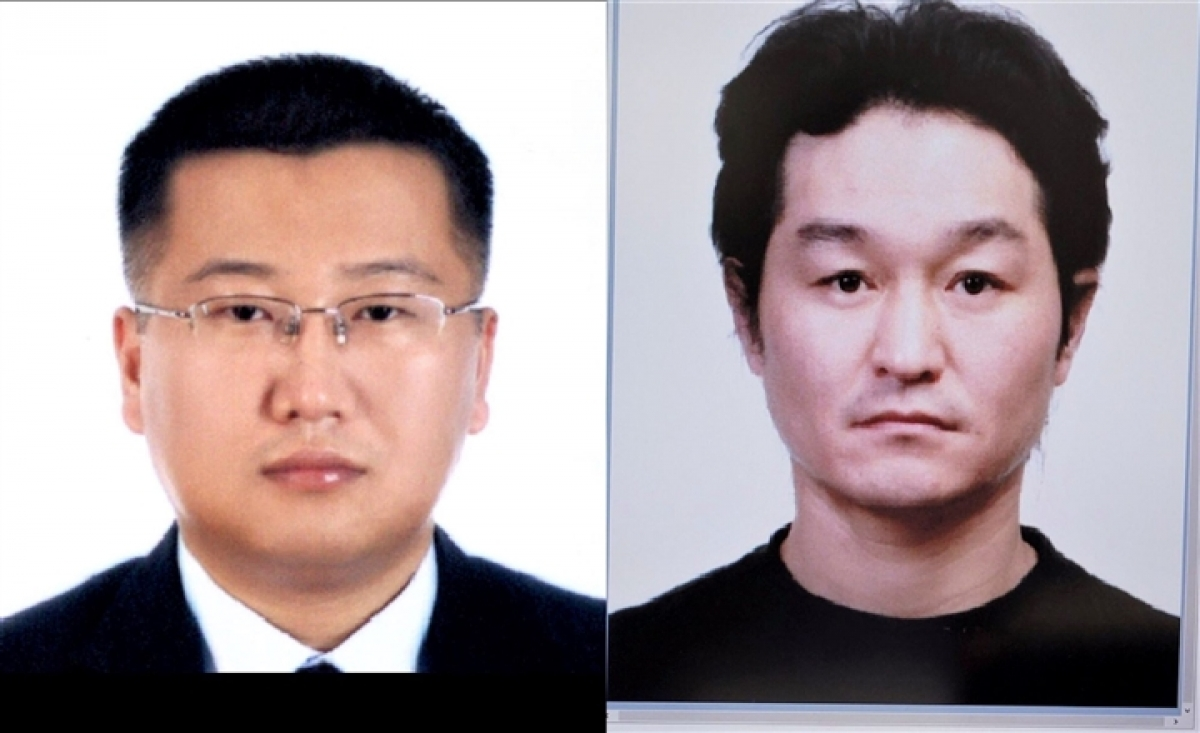 Yon Taiyi (left) andNam Kiwon,wanted by the INTERPOL,will be handed over to the Korean police at Da Nang International Airport.