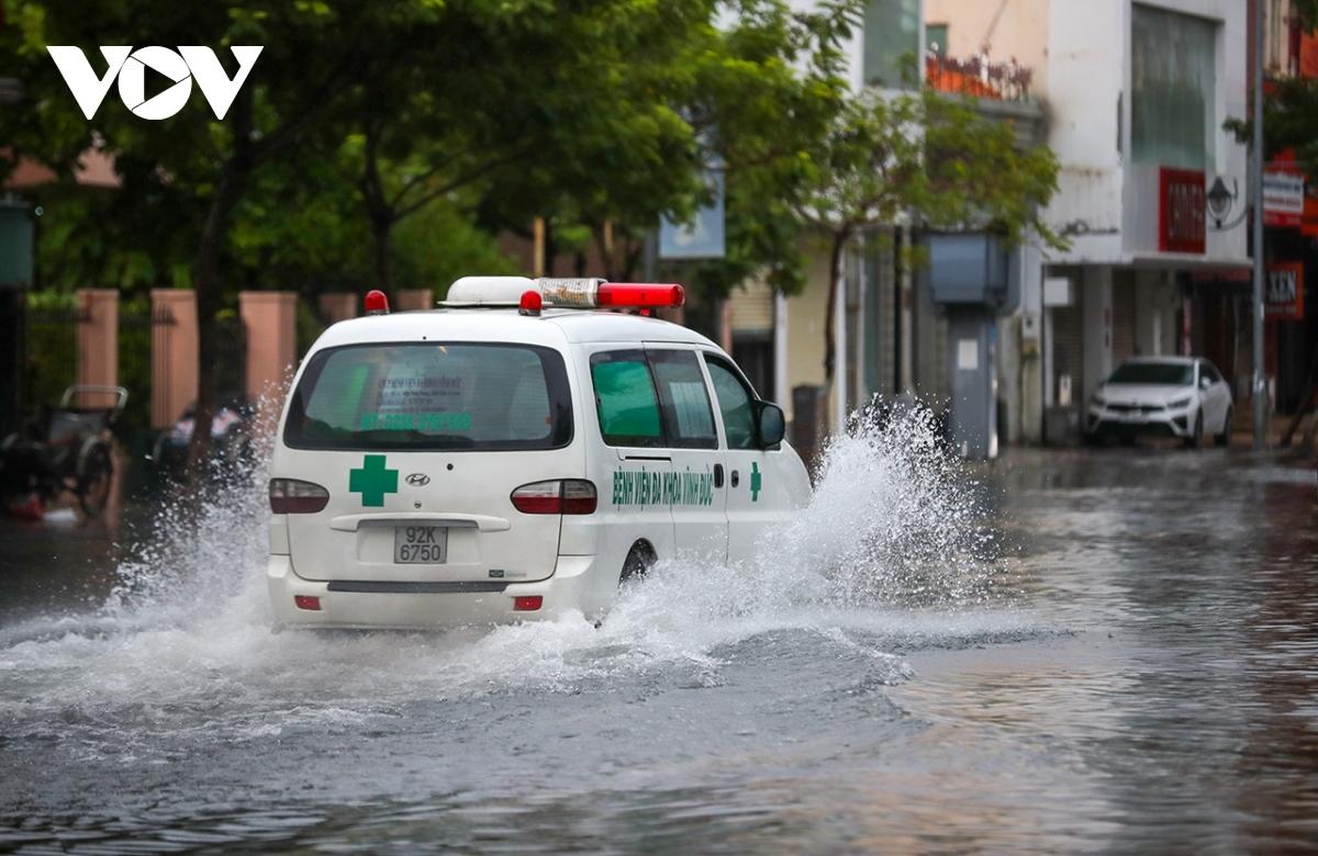 An emergency vehicle drives through Le Duan street.