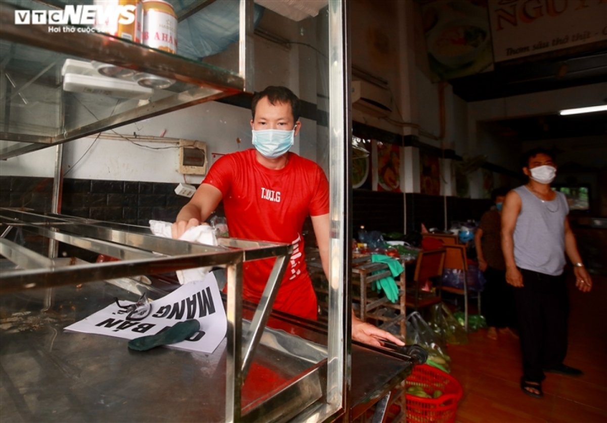 Cao Van Bay, 35, is a resident of in Trau Quy town and shares the happiness at operating his eatery again as it helps him to pay for his rental house each month.
