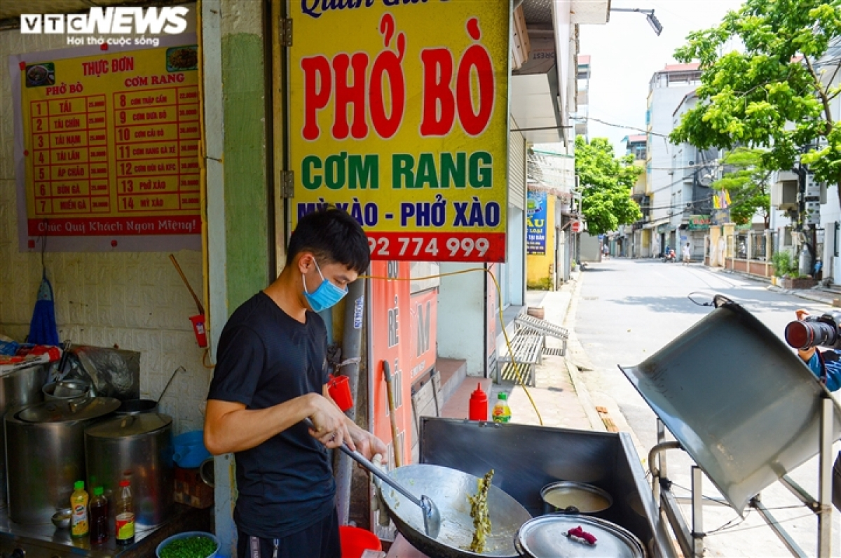 The owner of a food outlet is busy preparing materials from the early morning.