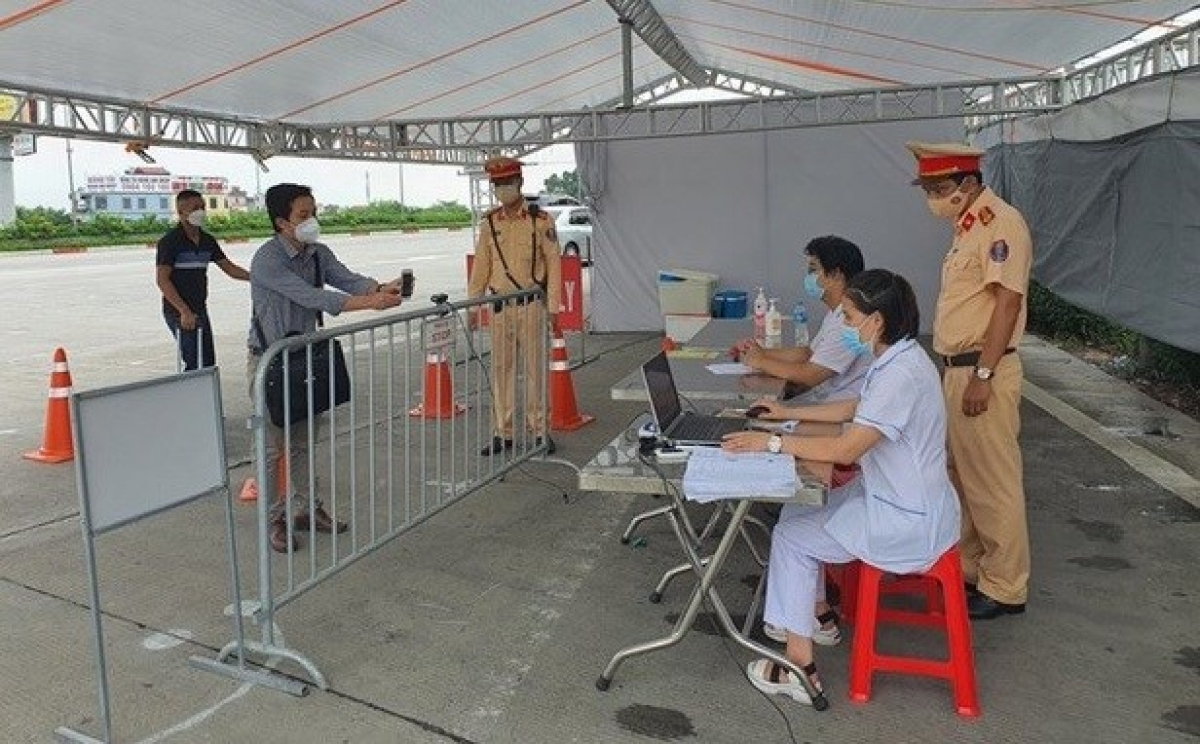 At a COVID-19 checkpoint in Hanoi