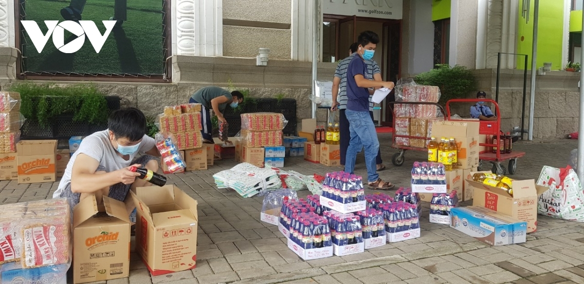 Traders in Binh Thuan ward of District 7 start to clean their shops on September 14 as they prepare to resume trading the following day.