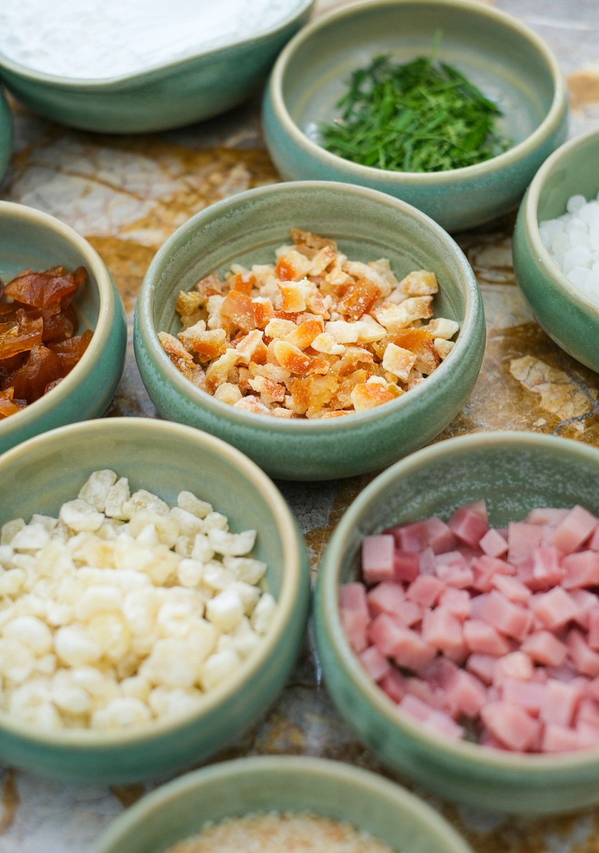 Traditional fillings remain popular, such as mixed, green beans, lotus seeds, green tea, taro, and salted eggs.