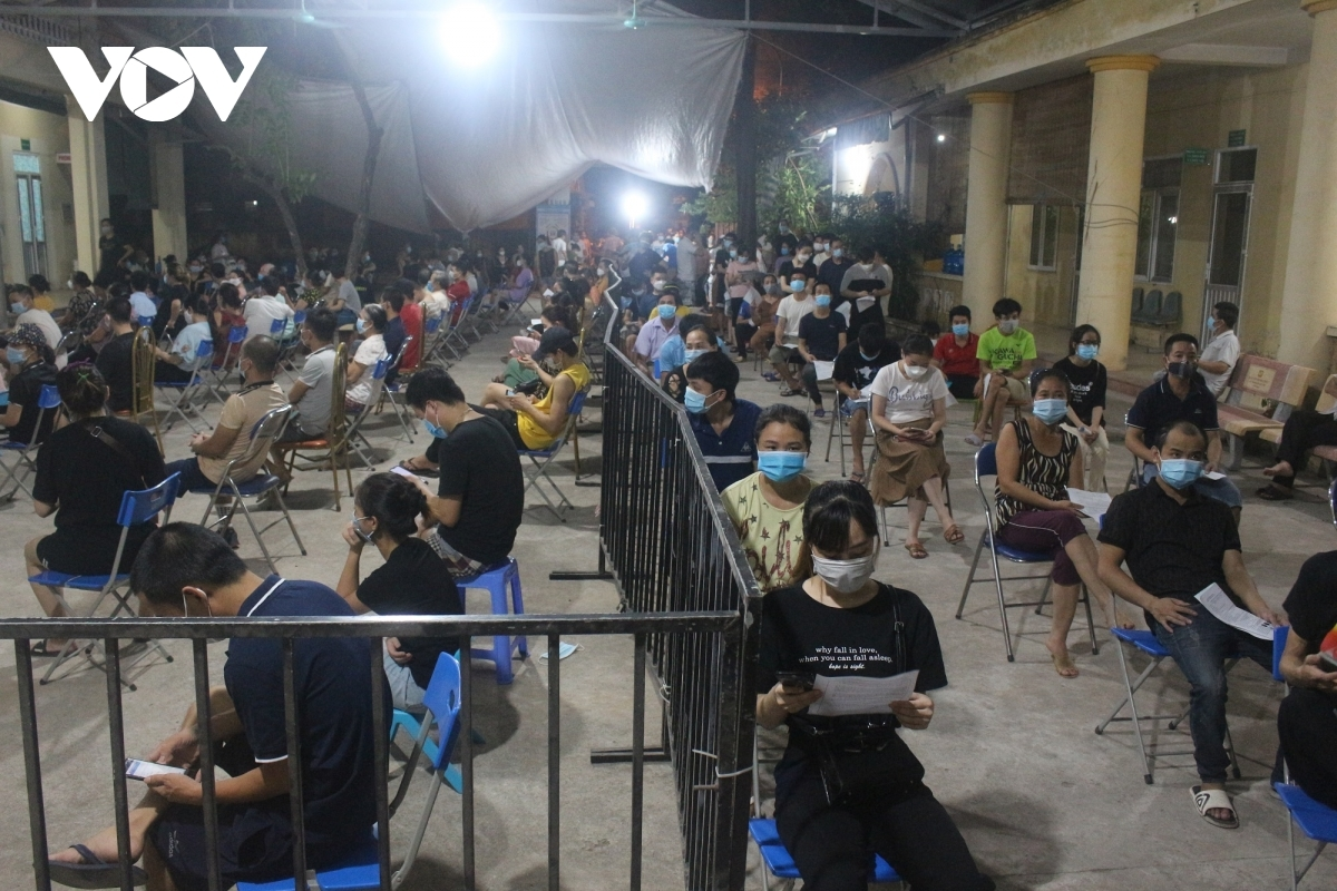 Hanoi is speeding up mass inoculation scheme, with thousands of citizens staying overnight waiting for vaccination against COVID-19.