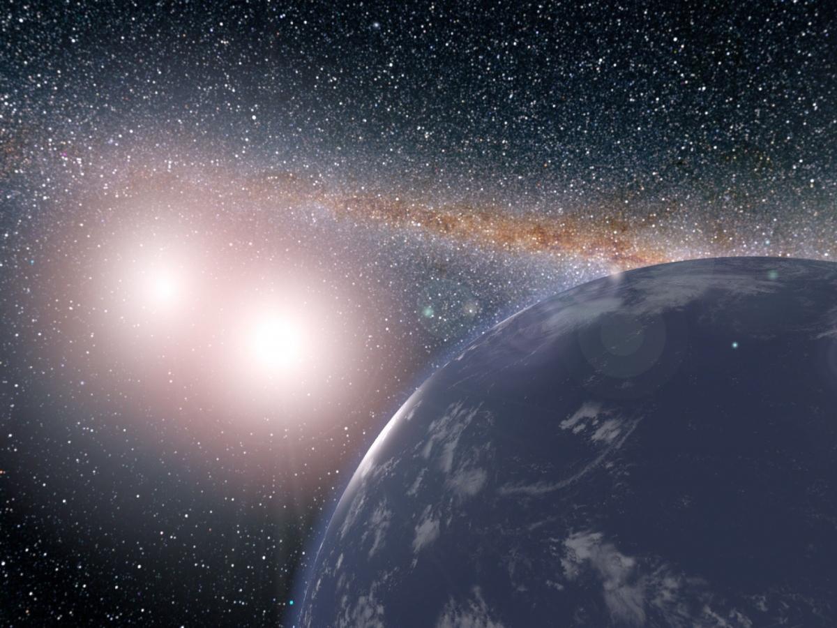 Hình ảnh minh họa từ NASA về một hành tinh trong giả thuyết được nước bao phủ và có 2 mặt trời.