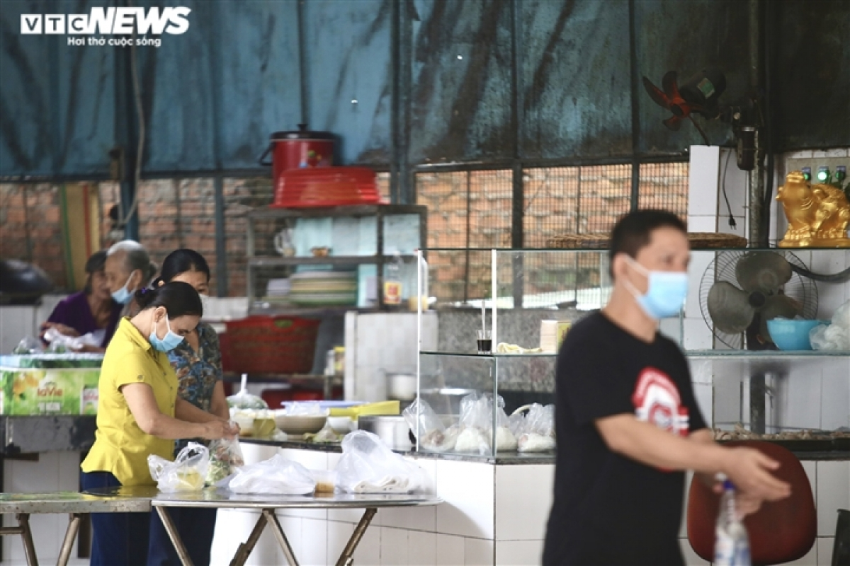 Cuong, the owner of a Pho (noodle soup) restaurant, says his family have all been inoculated with two doses of the COVID-19 vaccine and are eager to resume business operations.