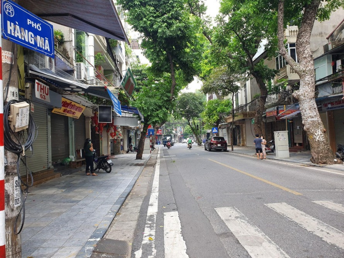 The street is located in the heart of Hoan Kiem district, one of the capital's red zones, meaning it is in the grip of strict social distancing measures for the COVID-19 fight.