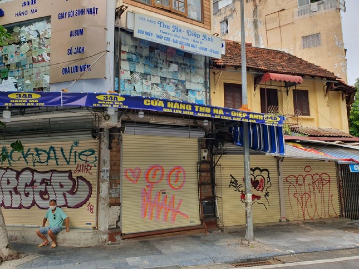 Hang Ma street appears both quiet and gloomy as non-essential shops are required to remain closed.