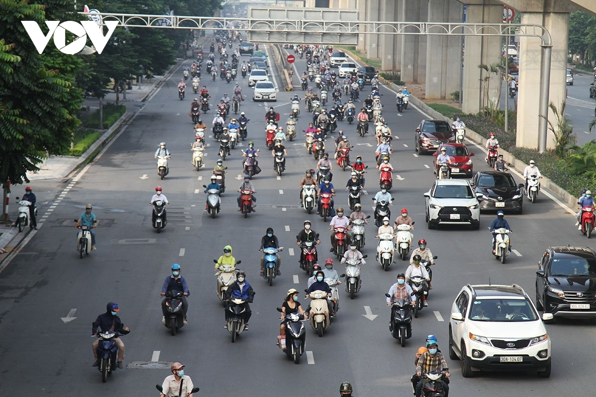 Local people head out in their droves as they return to their offices following Hanoi's authorities loosening novel coronavirus (COVID-19) restrictions.
