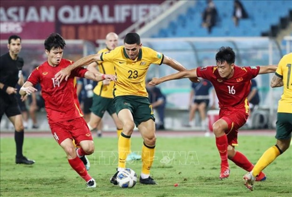 Players vie for the ball at the Vietnam-Australia game