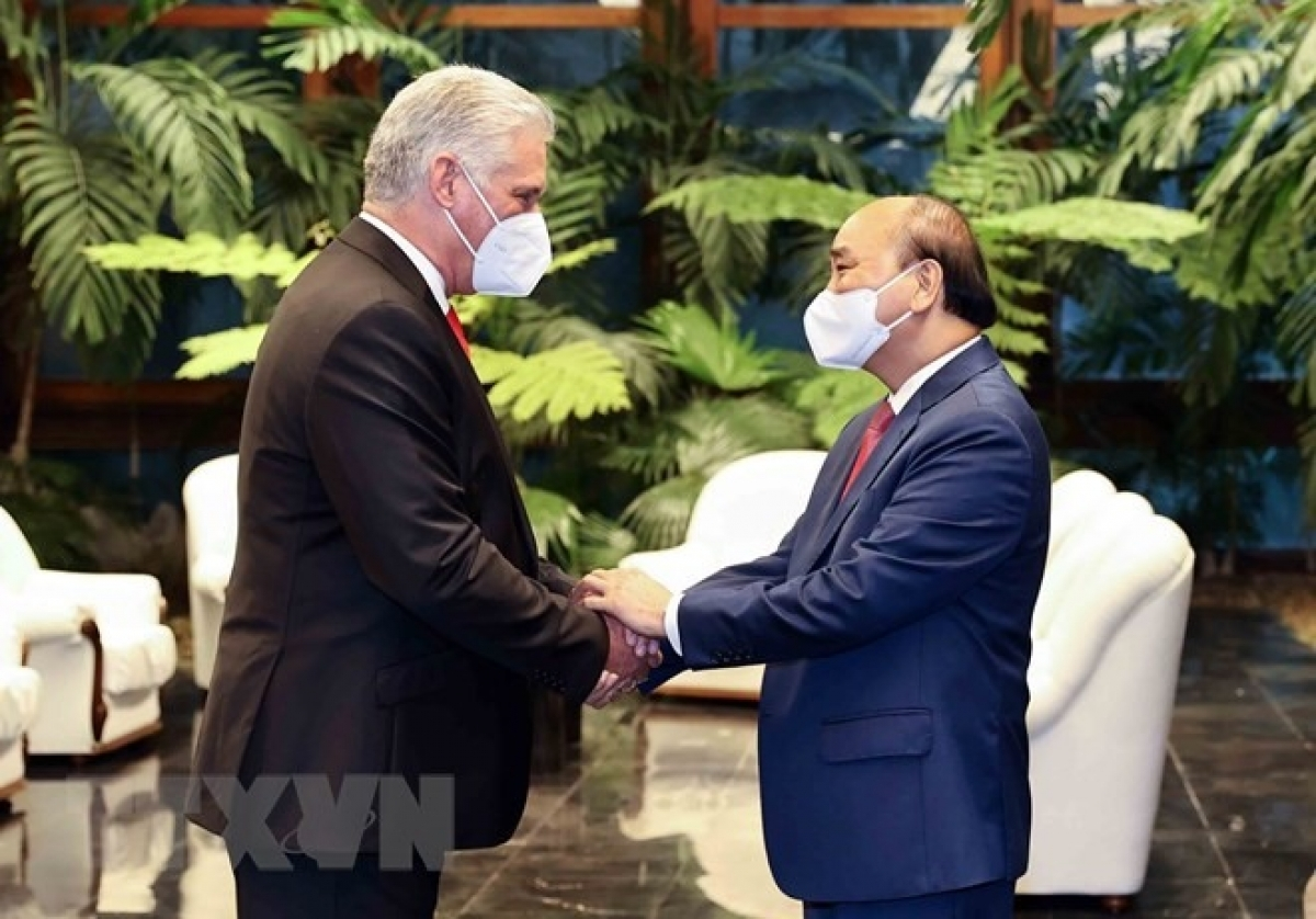 Cuban President Miguel Diaz-Canel (L) welcomes his Vietnamese counterpart Nguyen Xuan Phuc who is in Havana for an official visit to Cuba.