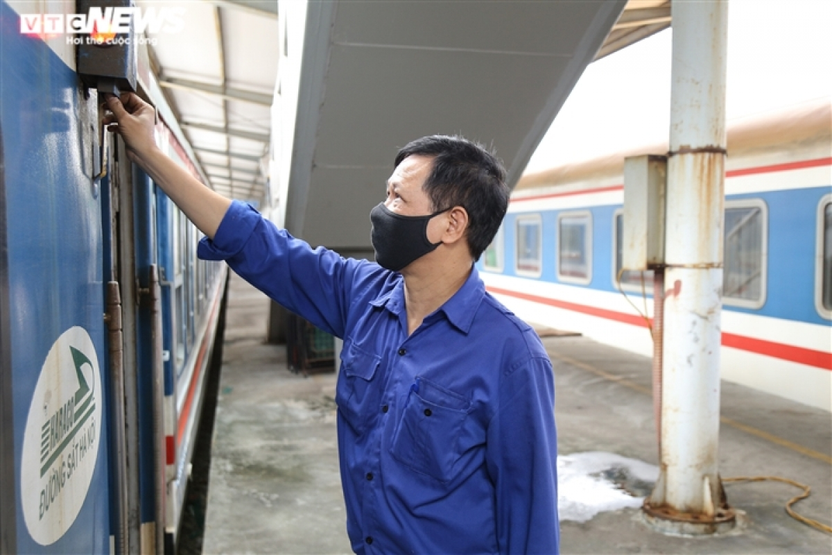 Workers at the Hanoi Railway Station gear up to welcome the return of passengers.