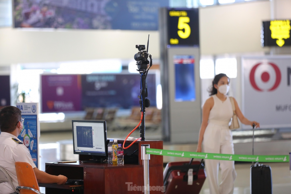 Thermographic cameras used to measure body temperatures are placed at the domestic arrival hall.