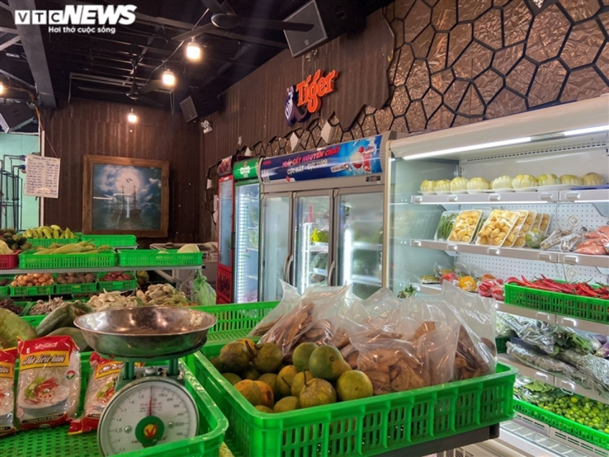 Essential food items are placed on sale at a mini supermarket.
