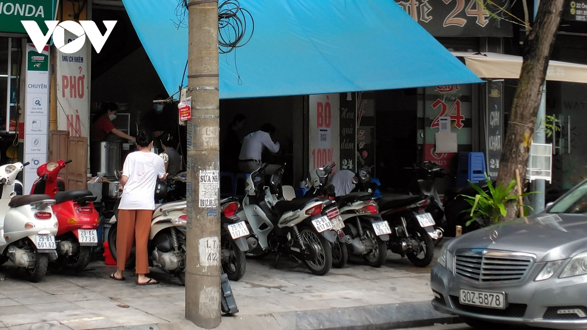 A Pho (noodle soup), restaurant on Ong Ich Khiem street is packed with vehicles at 7:30 a.m.