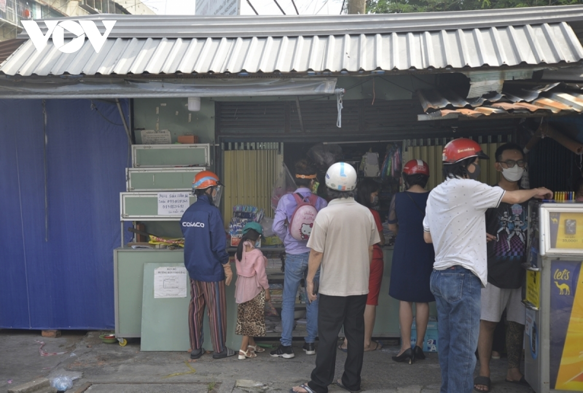 Local people gather to purchase school stationery products for their children in front of a store in Thu Duc City.