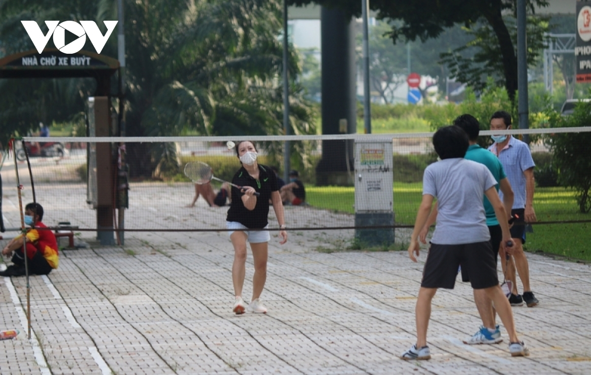 Local people play sports together in Gia Dinh park.